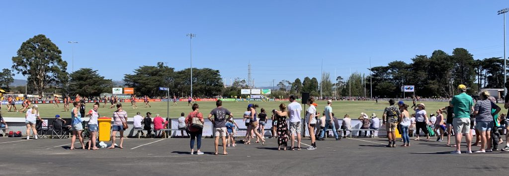 Crowd watching AFLW game between Collingwood and GWS at Morwell