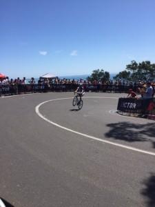 A Tour rider entertains the rowdy mob with a wheelie