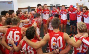 The Reserves, including nine Senior players, celebrating (NEAFL Website)